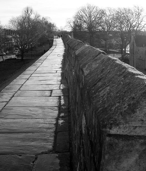 Black and white photograph of a long stretch of the Yort city wall.