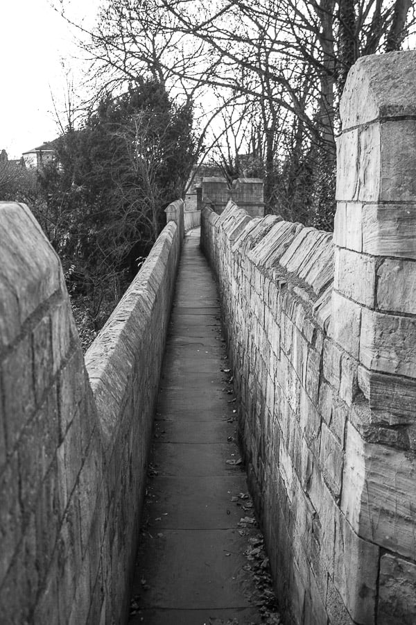 Black and white image of the pavement on the York wall walk.