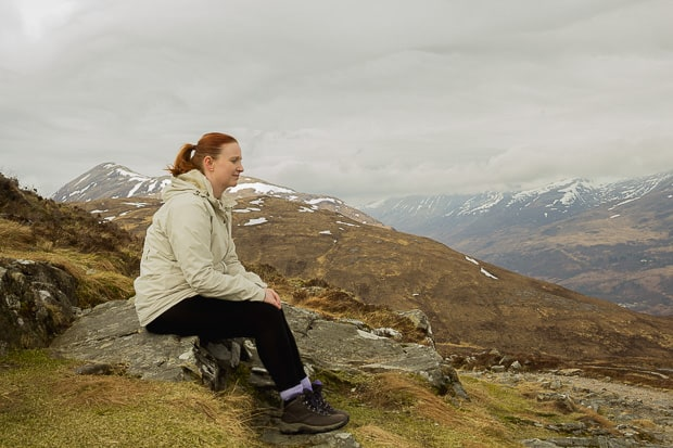 Lynne Lockier sitting on a rock on The West Highland Way.
