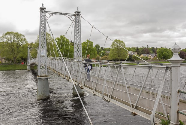 Lynne crossing over a swing bridge over the River Ness.