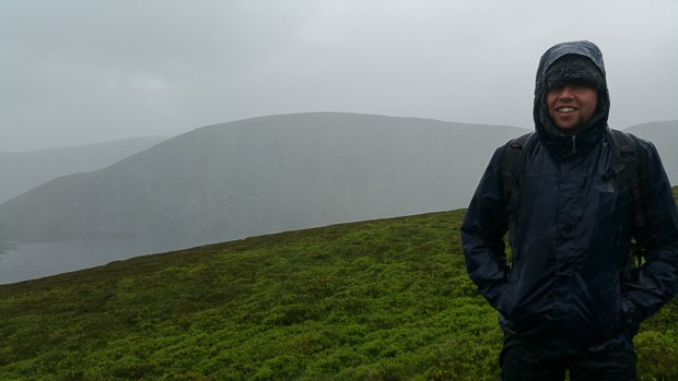 Liam standing with a view of the Glen Clova hills from the Loch Brandy path.