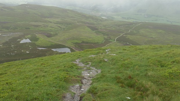 Looking back down the right shoulder of the circular walk around Loch Brandy after the summit of Green Hill.
