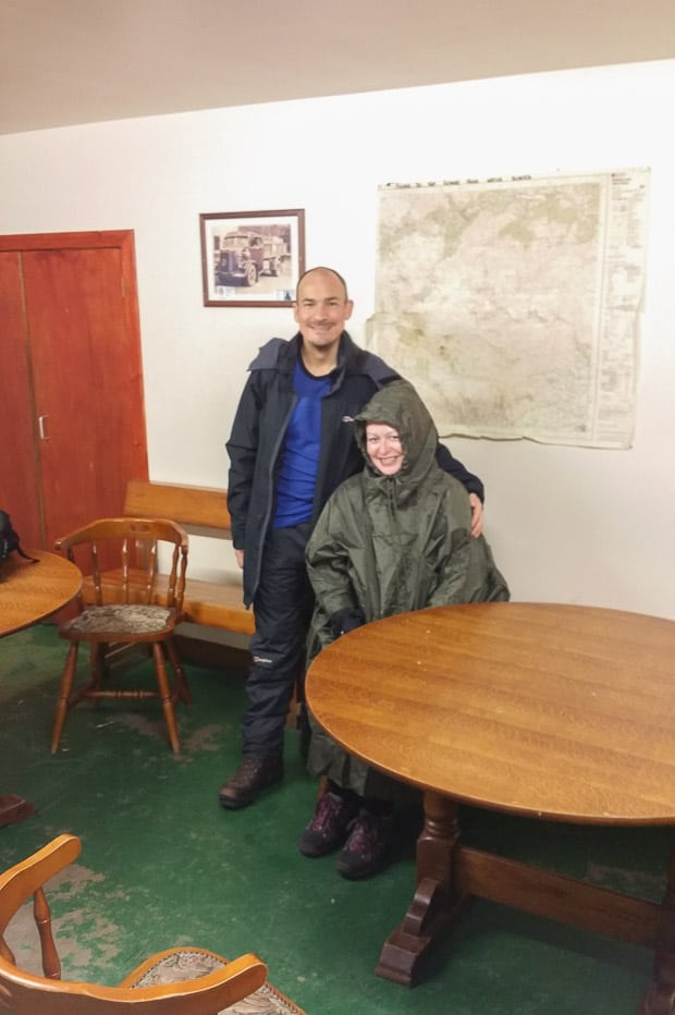 Neil and Catherine in our our waterproofs inside the Glen Clova Hotel Bunkhouse.