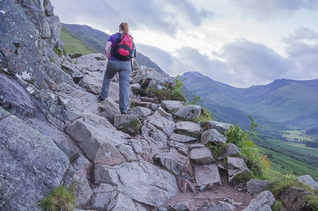 Lynne climbing a more difficult rocky part of the Ben Nevis path.