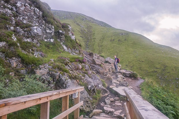 Bridge over river on Ben Nevis path with Lynne in the distance.