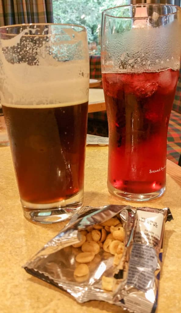 A pint of real ale and a pint of cider on a table in the Ben Nevis restaurant.