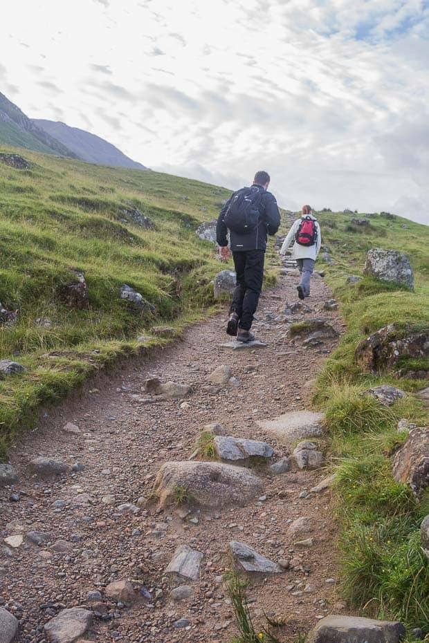 Lynne Lockier in front with Liam behind beginning the ascent of the Ben Nevis path.