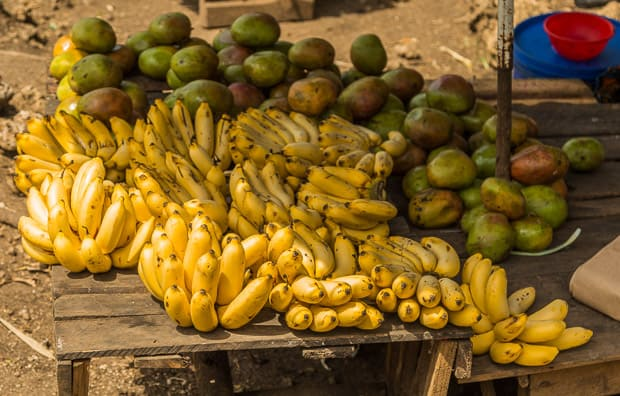 Bananas and Mangos for sale at a roadside fruit stall in Uganda.