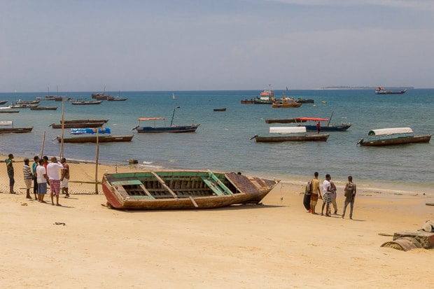 Large boat on the beach in Zanzibar harbour Stone town.