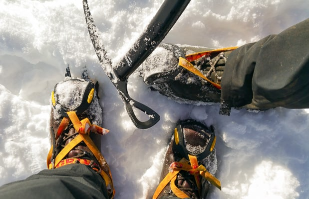 Looking down at our crampons and an ice axe.