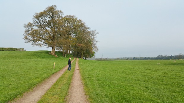 Lynne Lockier walking on a track on a field on route to Bowness on Solway.