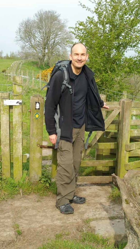 Hadrians Wall Walk. Carlisle to Bowness on Solway. Neil Lockier at a climbing stile.