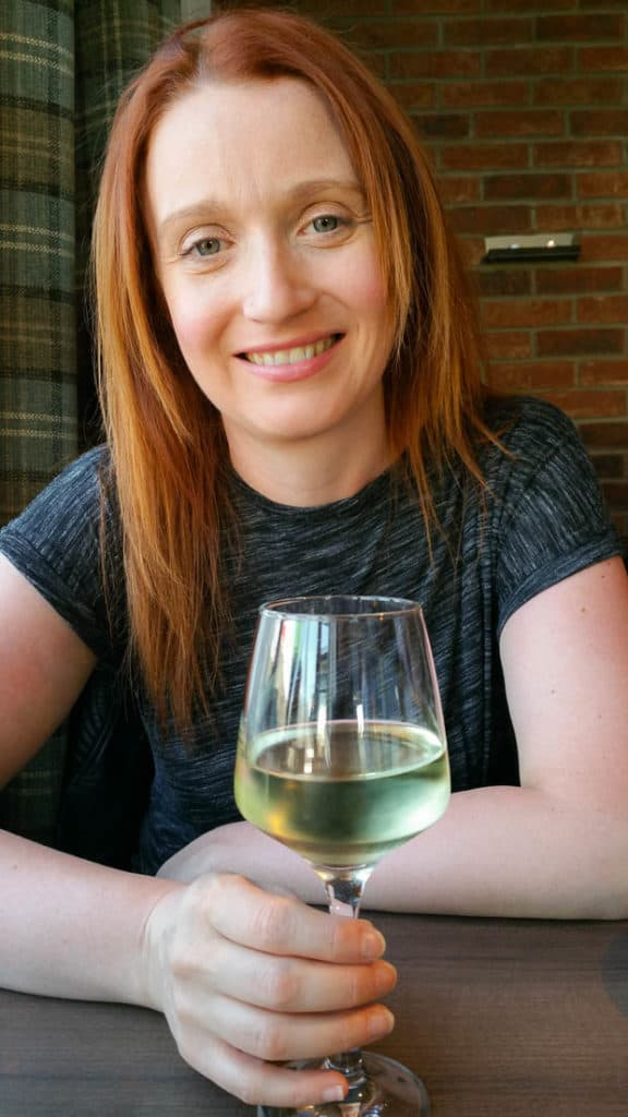 Lynne Lockier drinking wine at The Waterfront Fish House Oban.
