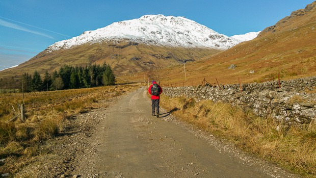 Path to foot of Beinn Tulaichean and Cruach Ardrain seen in March with snow on the mountain tops.