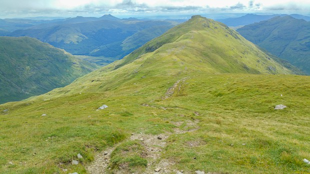 Looking back at Beinn Tulaichean from the slopes of Cruach Ardrain with a view of the mountains of Stirling and the Trossachs in the distance.