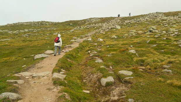 Lynne with waterproofs on walking up the plateau path to the summit of Lochnagar.