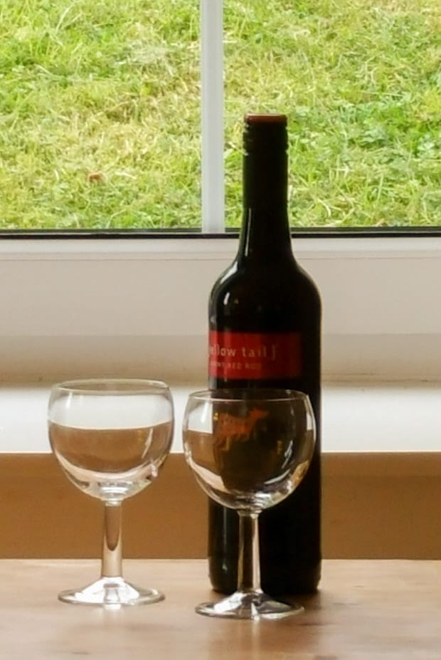 A bottle of Yellowtail wine with two wine glasses.