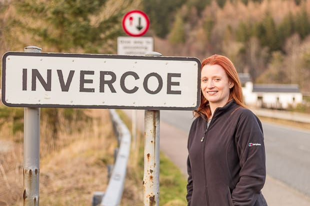 Lynne at Invercoe village sign.