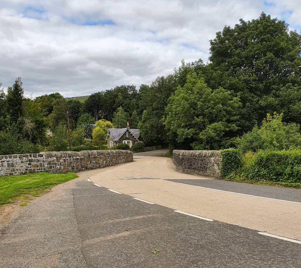 Bridge over Yarrow Water after North Lodge. East Lodge on opposite side of bridge with driveway to Broadmeadows House to the right.